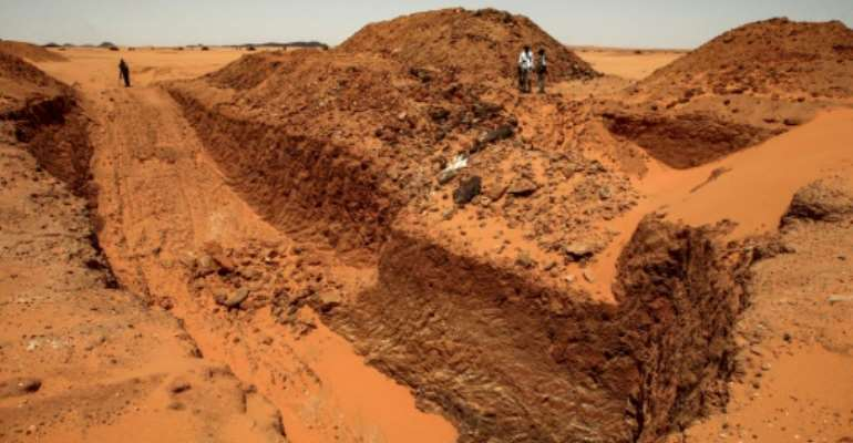 Treasure hunters looking for gold in Sudan have destroyed ancient sites using diggers.  By Ebrahim HAMID (AFP Photo)