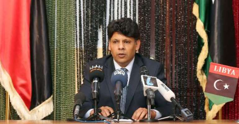 Seddik al-Sour, spokesman for the Libya state prosecutor's office, speaks during a press conference on March 24, 2014, in Tripoli.  By Mahmud Turkia (AFP)
