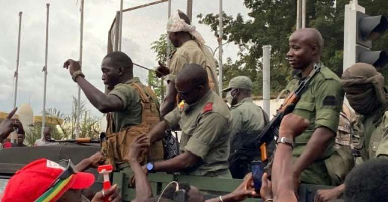 Troops are greeted by cheering crowds as they arrive at Independence Square in Bamako.  By MALIK KONATE (AFP)