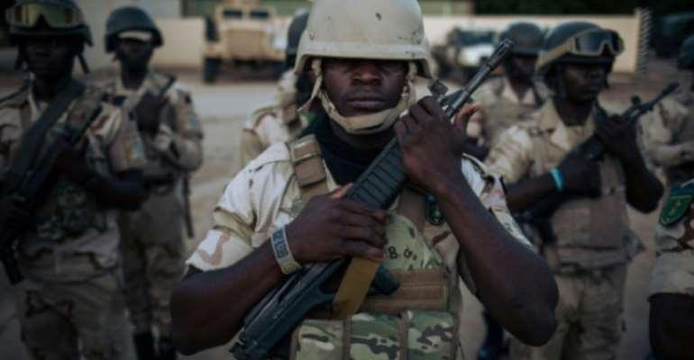 Troops in majority-francophone Cameroon's two English-speaking regions have been battling separatists since 2017.  By ALEXIS HUGUET (AFP)