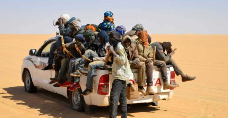 Trucks carrying migrants north frequently breakdown in the desert or become lost, with smugglers sometimes abandoning people to their fates.  By SOULEMAINE AG ANARA (AFP)