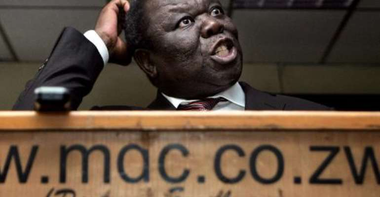 Zimbabwe main opposition leader Morgan Tsvangirai of the Movement for Democratic Change (MDC) gives a press conference in Harare March 25, 2014.  By Jekesai Njikizana (AFP/File)