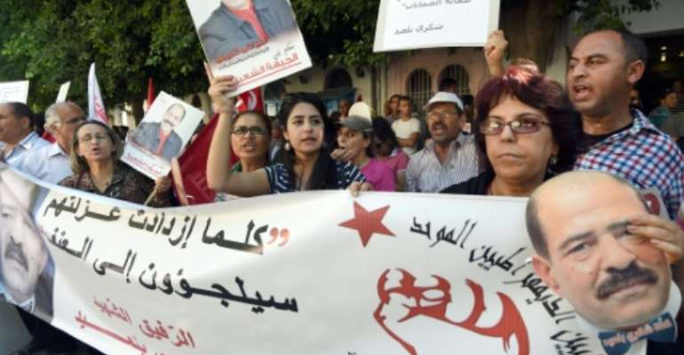 Tunisian demonstrators in front of the court in Tunis on June 30, 2015, during the trial of 24 people accused of the assassination of opposition leader, Chokri Belaid.  By Fethi Belaid (AFP/File)