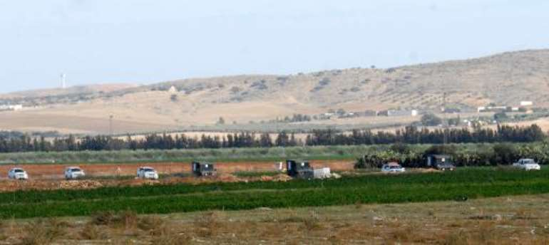 Tunisian police and army vehicles take part in a military operation to hunt down a jihadist cell on October 19, 2013 near Goubellat in the Mount Taouyer area of Beja region.  By Khalil (AFP/File)