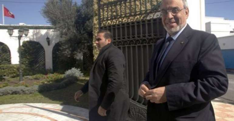 Tunisian PM Hamadi Jebali (right) arrives to meet the Progressive Democratic Party in Tunis on February 14, 2013.  By Hasna (AFP)