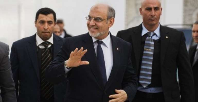 Tunisian PM Hamadi Jebali (C) waves as he arrives for a round of political talks in Carthage on February 15, 2013.  By Gianluigi Guercia (AFP/File)