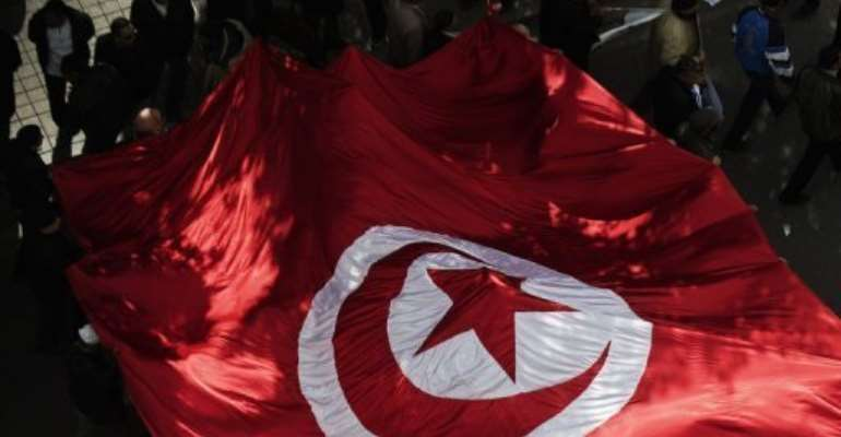 Tunisian Ennahda party supporters march through Tunis's Habib Bourguiba Avenue on February 16, 2013.  By Gianluigi Guercia (AFP/File)