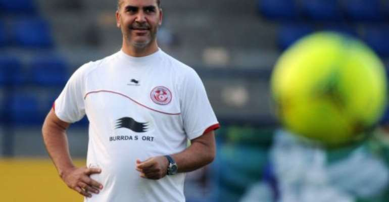 Tunisian coach Sami Trabelsi looks at players during a training session in Bongoville.  By Pius Utomi Ekpei (AFP/File)