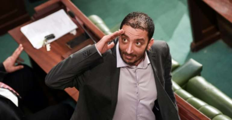 Tunisian parliamentarian Yassine Ayari gestures during a session in the capital Tunis on February 15, 2018 -- his vocal criticism of authorities has brought him many run-ins with the law.  By FETHI BELAID (AFP/File)