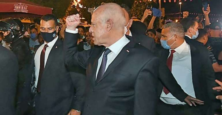 Tunisian President Kais Saied gestures to supporters on a walkabout in central Tunis the day after he launched his power grab.  By - (Tunisian presidency Facebook page/AFP/File)