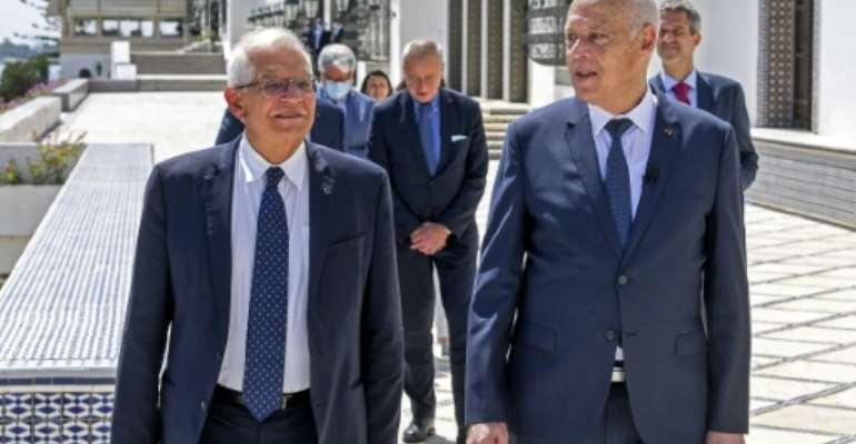 Tunisian President Kais Saied (R) receives European Union foreign policy chief Josep Borrell at Carthage Palace in the capital Tunis.  By STRINGER (TUNISIAN PRESIDENCY/AFP)