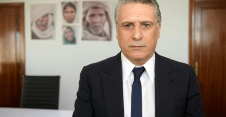 Tunisian presidential candidate Nabil Karoui, arrested on money laundering charges, is to stay behind bars after a third appeal for his release was turned down.  By FETHI BELAID (AFP/File)