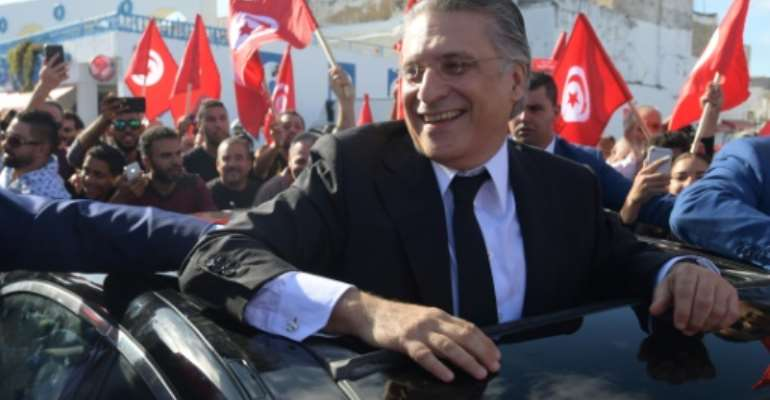 Tunisian presidential candidate Nabil Karoui meets his supporters in the northern city of Bizerte on October 11, 2019 two days before a runoff vote pitting him against independent conservative academic Kais Saied.  By FETHI BELAID (AFP)