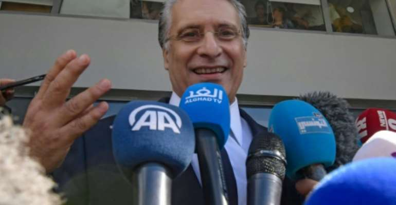 Tunisian presidential candidate Nabil Karoui says he is ready to take on the runoff vote on Sunday against his rival a day after his release from weeks in jail where he was held over a money laundering probe.  By FETHI BELAID (AFP)