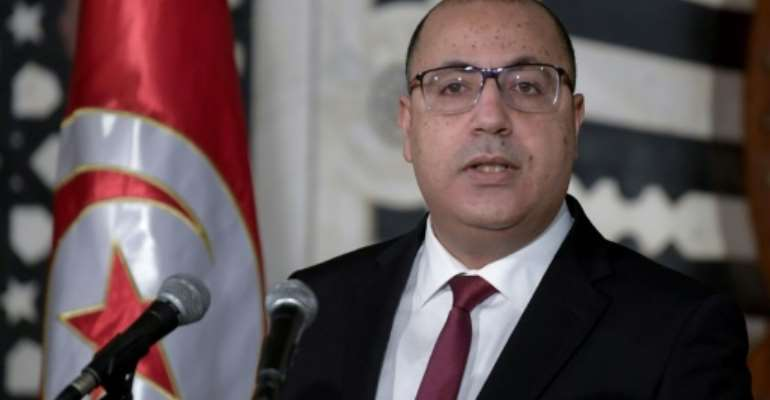 Tunisian Prime Minister Hichem Mechichi announced a cabinet reshuffle at a press conference in the capital Tunis.  By FETHI BELAID (AFP)