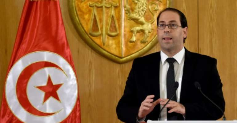 Tunisian Prime Minister Youssef Chahed, seen in August 2016, said the transition to democracy was costly for his country, which relies on France for help