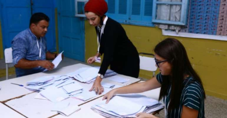 Tunisian volunteers count ballots at a polling station in Sousse, south of the capital Tunis.  By ANIS MILI (AFP)
