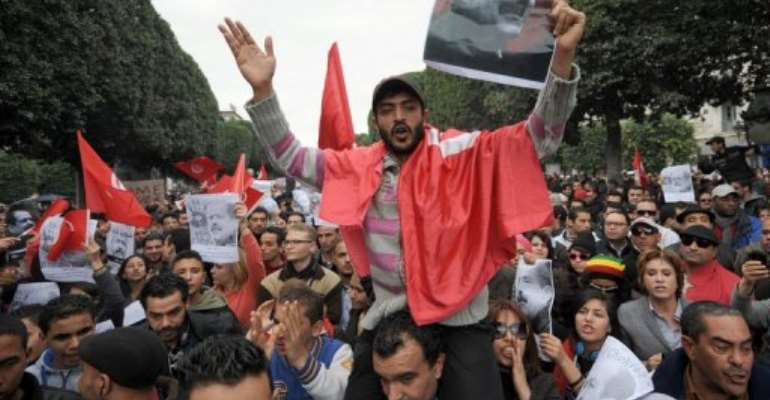 Tunisian protesters shout slogans during a demonstration on February 23, 2013 in Tunis.  By Fethi Belaid (AFP/File)