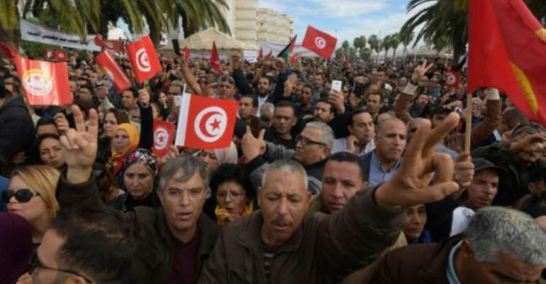 Tunisians protest in the capital Tunis during a general strike by civil servants on November 22, 2018.  By FETHI BELAID (AFP)