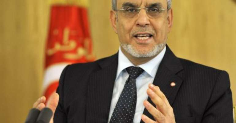 Tunisian Prime Minister Hamadi Jebali talks to the press on January 26, 2013 in Tunis.  By Fethi Belaid (AFP/File)