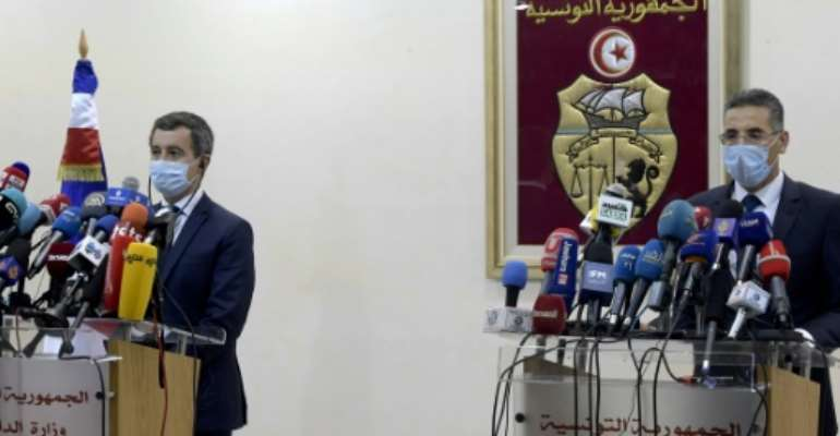 Tunisia's Interior Minister Taoufik Charfeddine (R) gives a joint press conference with his French counterpart Gerald Darmanin in the capital Tunis on Friday.  By FETHI BELAID (AFP)