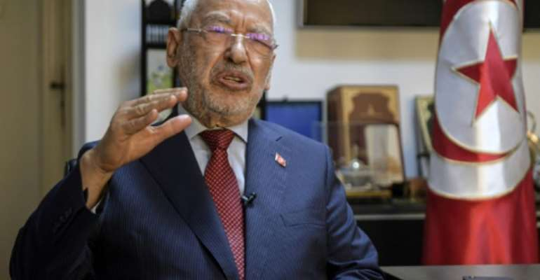 Tunisia's parliament speaker and head of the Islamist-inspired Ennahdha party Rached Ghannouchi is calling for a