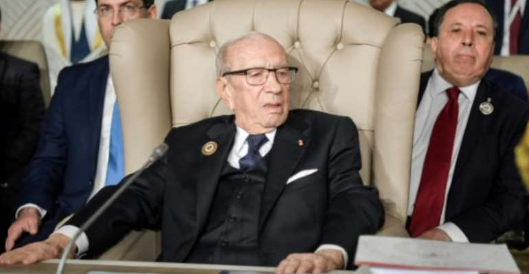 Tunisia's President Beji Caid Essebsi is doing well, his office says, a day after he fell ill.  By FETHI BELAID (POOL/AFP/File)