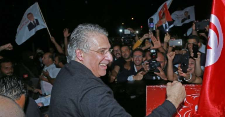 Tunisia's presidential candidate Nabil Karoui is greeted by his supporters after being released from Mornaguia prison near the capital Tunis ahead of Sunday's runoff.  By ANIS MILI (AFP)