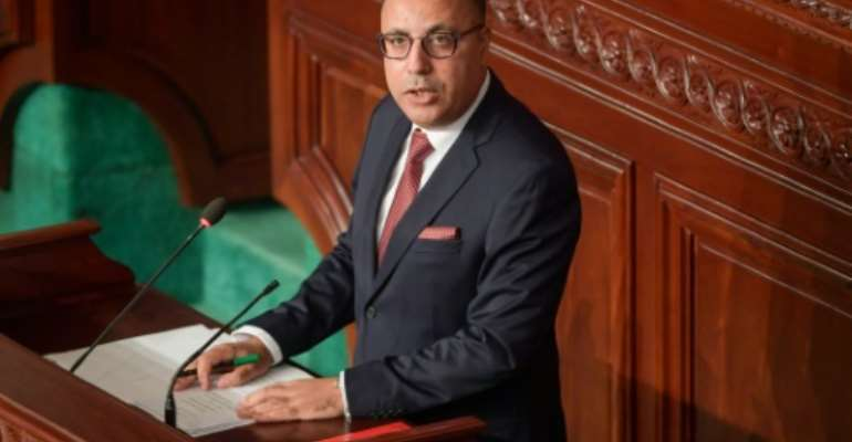 Tunisia's prime minister-designate Hichem Mechichi delivers a speech as parliament readies for a confidence vote.  By Fethi Belaid (AFP)