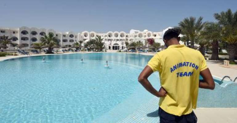 It's another sun-drenched day but the deckchairs of a four-star hotel on the island of Djerba stand empty, in a sign of the
