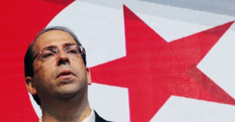 Tunisia's youngest Prime Minister Youssef Chahed is hoping to win the country's September 15 presidential polls.  By HASNA (AFP/File)