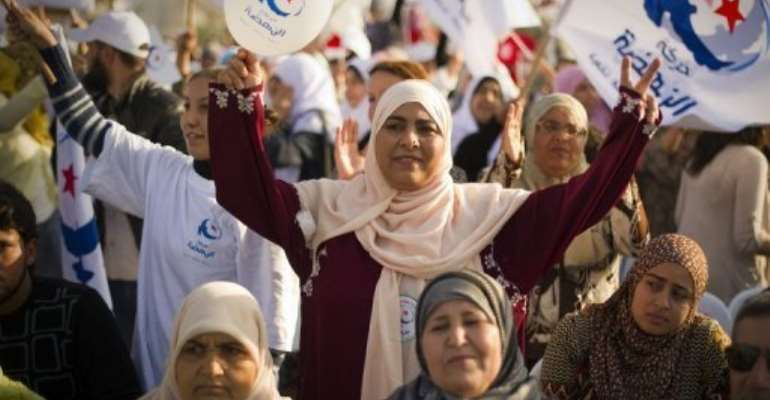 Supporters of the Islamist Ennahda party at a rally in Ben Arous, southern Tunis, yesterday.  By Lionel Bonaventure (AFP)