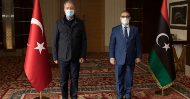 Turkey's Defence Hulusi Akar (L) made an unexpected visit to Libya where he met top officials including Khaled el-Mechri who heads the High State Council aligned with the Tripoli-based UN-recognised Government of National Accord.  By - (AFP)