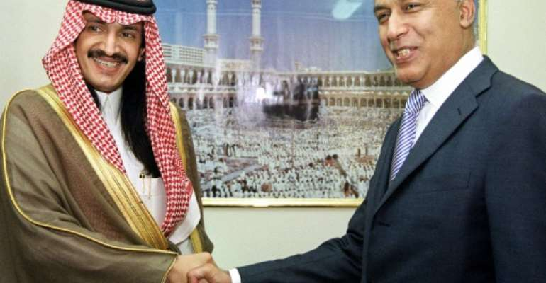 Turki bin Bandar bin Mohamed bin Abderrahmane al-Saud shakes hands with Pakistan's Finance Minister Shaukat Aziz in Islamabad in a file picture from 15 September 2003.  By FAROOQ NAEEM (AFP)