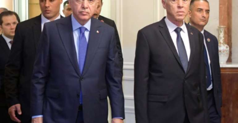 Turkish President Recep Tayyip Erdogan (L) and Tunisian President Kais Saied at the presidential palace in Carthage, east of the capital Tunis.  By FETHI BELAID (AFP)