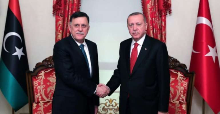 Turkish President Recep Tayyip Erdogan (R) meets with Fayez al-Sarraj, the head of the Tripoli-based Government of National Accord in Istanbul on November 27, 2019.  By Mustafa Kamaci (TURKISH PRESIDENTIAL PRESS SERVICE/AFP/File)