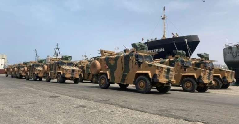 Turkish-built armoured vehicles unloaded at Tripoli port.  By - (Media Bureau of