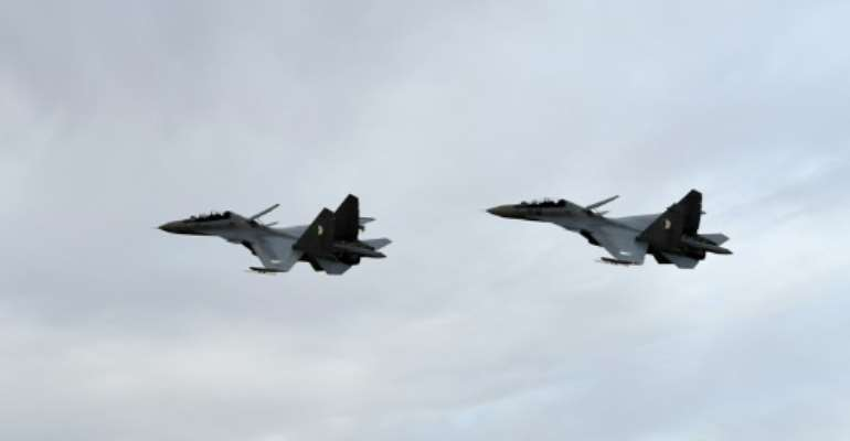 Two Algerian Sukhoi Su-30 fighter jets take part in manoeuvres in April last year.  By Handout (Algerian Ministry of National Defense/AFP/File)