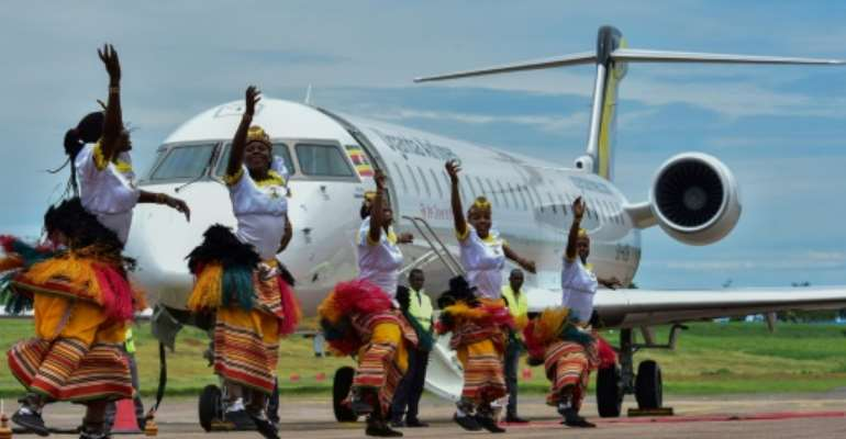 Two Bombardier CRJ900 jet airliners, which can carry up to 90 people each, landed at Entebbe airport outside the capital Kampala during a ceremony attended by President Yoweri Museveni.  By Nicholas BAMULANZEKI (AFP)