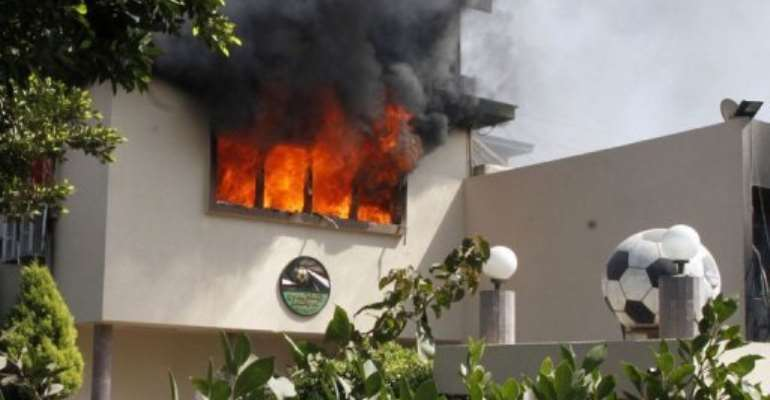 Flames rise from a room at the headquarters of the Egyptian Football Association in Cairo on March 9, 2013.  By  (AFP)