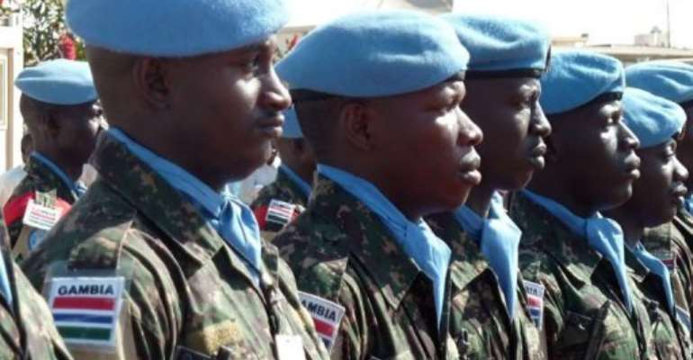 UN peacekeepers of UNAMID stand guard in North Darfur in January.  By Ian Timbarlake (AFP/File)