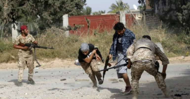 Two Libyan journalists detained more than three weeks ago while covering fighting on the outskirts of Tripoli have been released.  By Mahmud TURKIA (AFP/File)