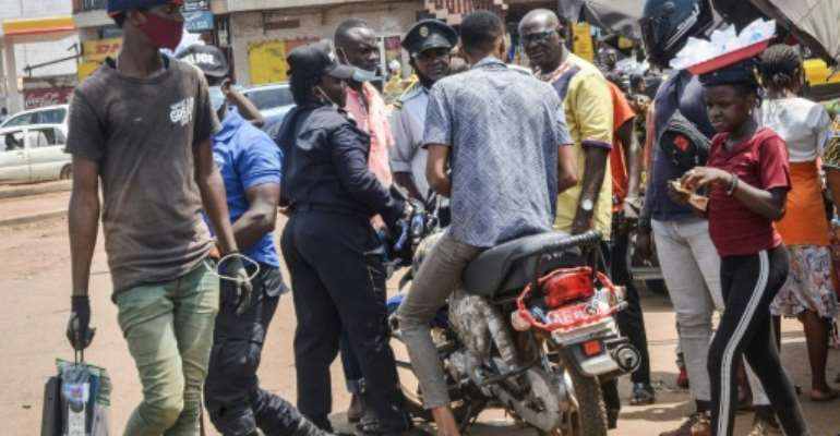 Two wheels bad: Police stop a motorcycle taxi driver in Conakry.  By CELLOU BINANI (AFP)