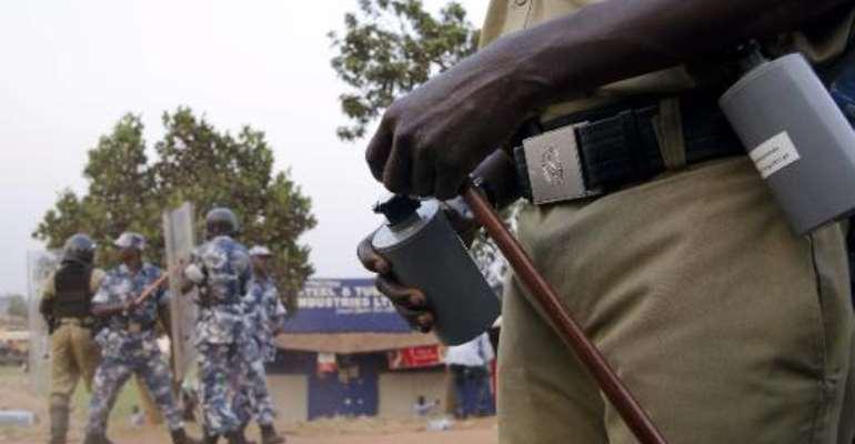 Ugandan riot police stand guard in Kampala on January 24, 2012.  By Michele Sibiloni (AFP/File)