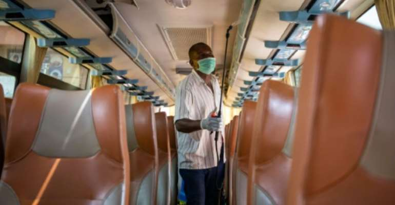 Uganda is battling to get citizens to comply with measures to curb the virus, with many new infections from public transport.  By Badru KATUMBA (AFP/File)