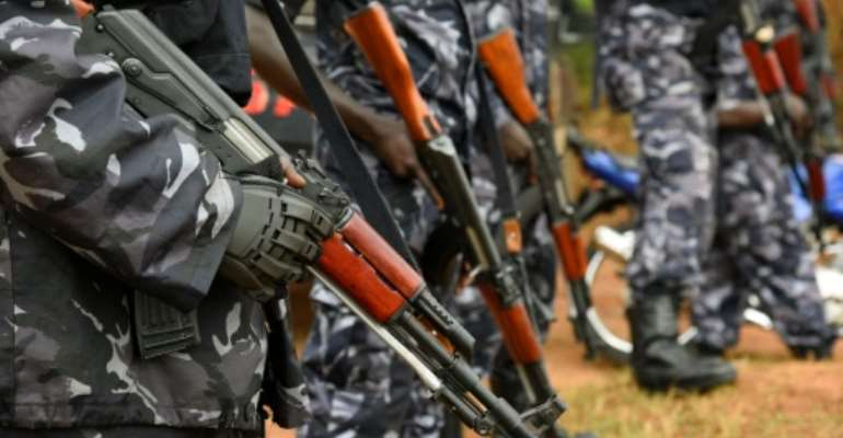 Ugandan police officers stand guard on February 22, 2016 in Kasangati.  By Isaac Kasamani (AFP/File)