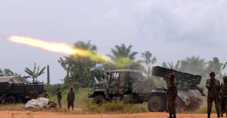 DR Congo troops battle rebels of ADF-Nalu, a Ugandan Islamist group based on the Congolese side of the border, near Kokola in 2014.  By Alain Wandimoyi (AFP/File)