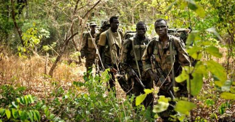 Ugandan soldiers patrol on April 18, 2012 through the Central African jungle during an operation to fish out notorious Lord's Resistance Army (LRA) leader Joseph Kony.  By Yannick Tylle (AFP/File)