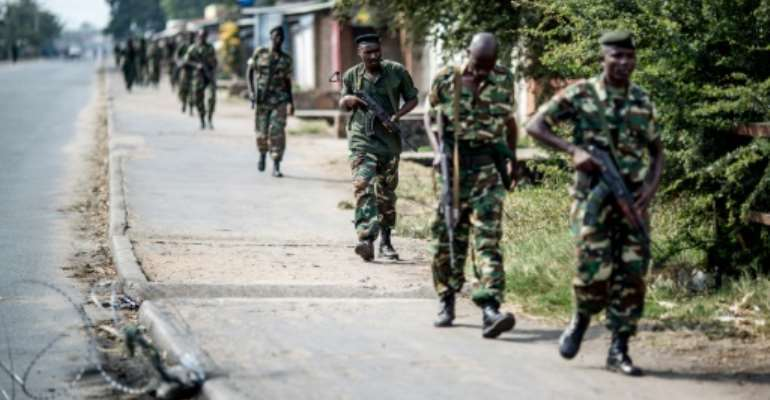Burundian soldiers withdrawing from the restive Cibitoke neighbourhood in Bujumbura after a police operation during the celebrations of the country's 53rd Independence Anniversary on July 1, 2015.  By Marco Longari (AFP/File)