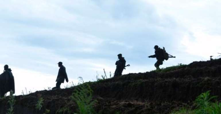 Democratic Republic of Congo soldiers advance on November 5, 2013 near Chanzu, 80 kilometres north of regional capital Goma.  By Junior D. Kannah (AFP/File)